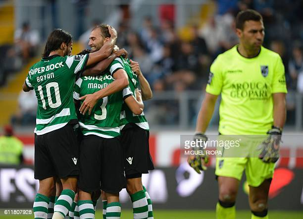 Sporting's Serbian forward Lazar Markovic celebrates with teammates after scoring a goal during the Portuguese league football match Vitoria SC vs...