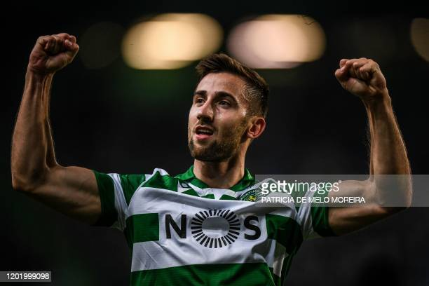 Sporting's Slovak forward Andraz Sporar celebrates after scoring during the Europa League round of 32 football match between Sporting CP and Istanbul...