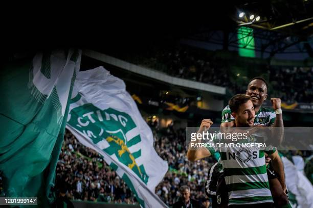 Sporting's Slovak forward Andraz Sporar celebrates with his teammate Sporting's Cape Verdean Jovane Cabral during the Europa League round of 32...