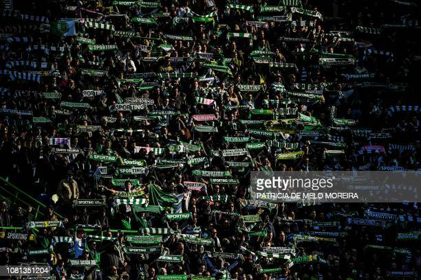 Sporting's supporters hold their scarfs during the Portuguese League football match between Sporting CP and FC Porto at the Jose Alvalade stadium in...