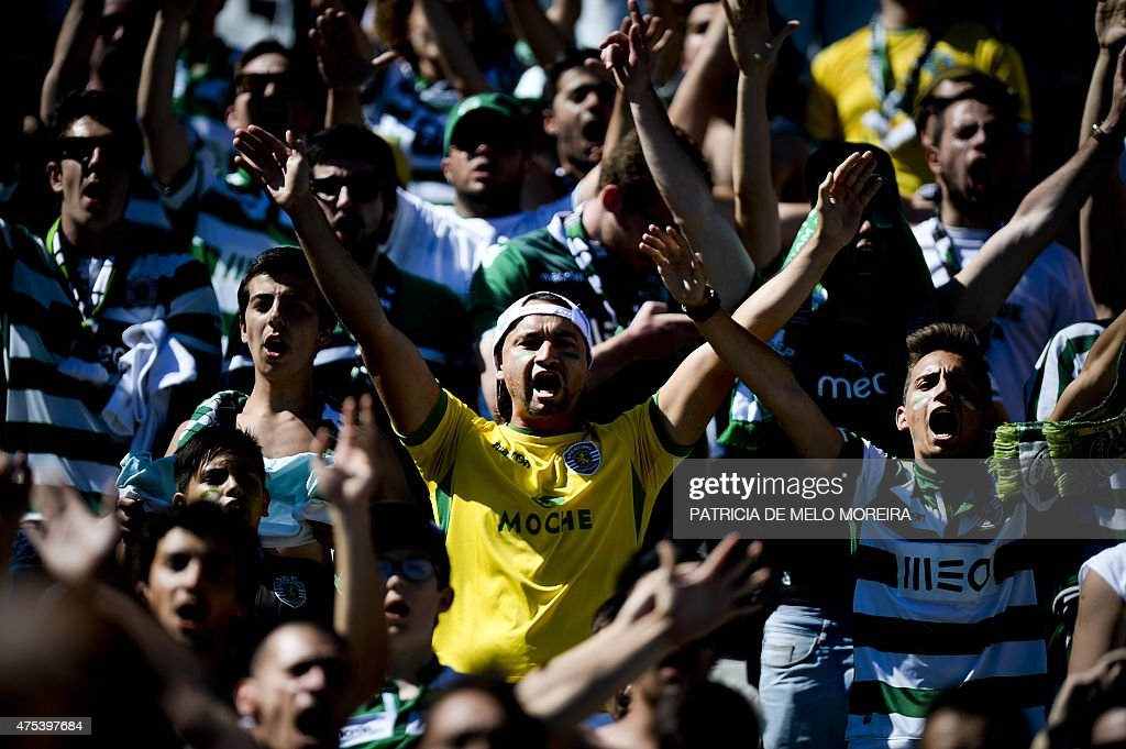 Sporting's supporters wave flags and shout slogans moments before the Taca de Portugal (Portuguese Cup) football match final Sporting CP vs SC Braga at Jamor stadium in Oeiras, outskirts of Lisbon on May 31, 2015.