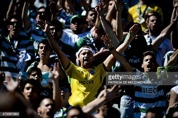 Sporting's supporters wave flags and shout slogans moments before the Taca de Portugal football match final Sporting CP vs SC Braga at Jamor stadium...