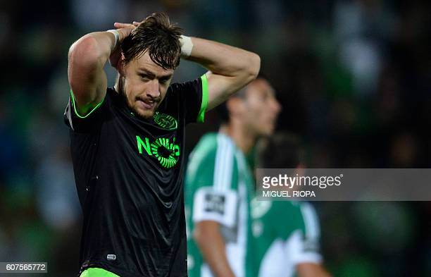 Sporting's Uruguayan defender Sebastian Coates gestures after missing a goal opportunity during the Portuguese league football match Rio Ave FC vs...