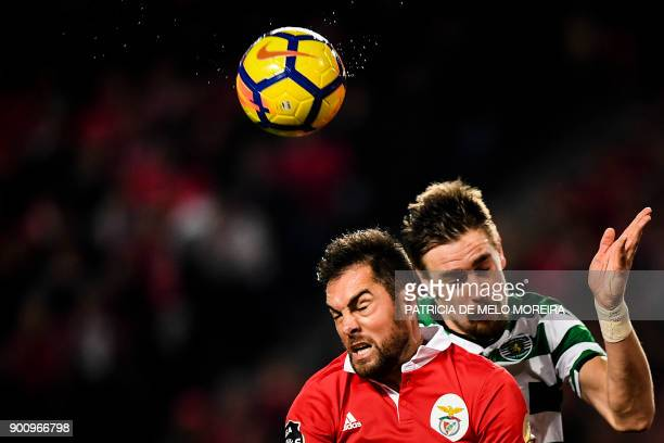Sporting's Uruguayan defender Sebastian Coates heads the ball with Benfica's Brazilian defender Jardel during the Portuguese league football match SL...