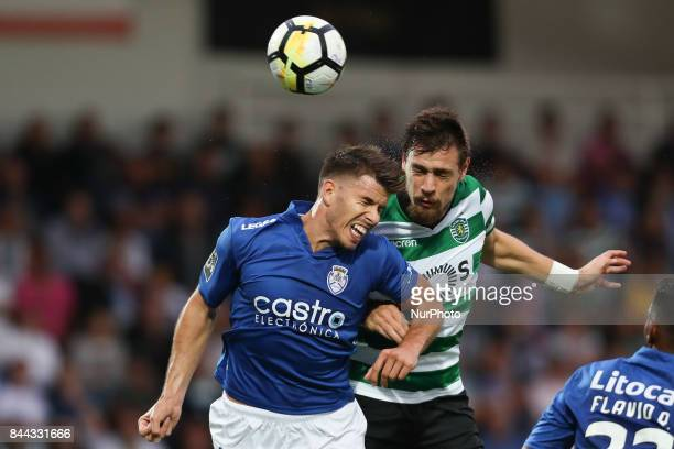 Sporting's Uruguayan defender Sebastian Coates vies with Feirense's Portuguese forward Ze Pedro during the Premier League 2017/18 match between CD...