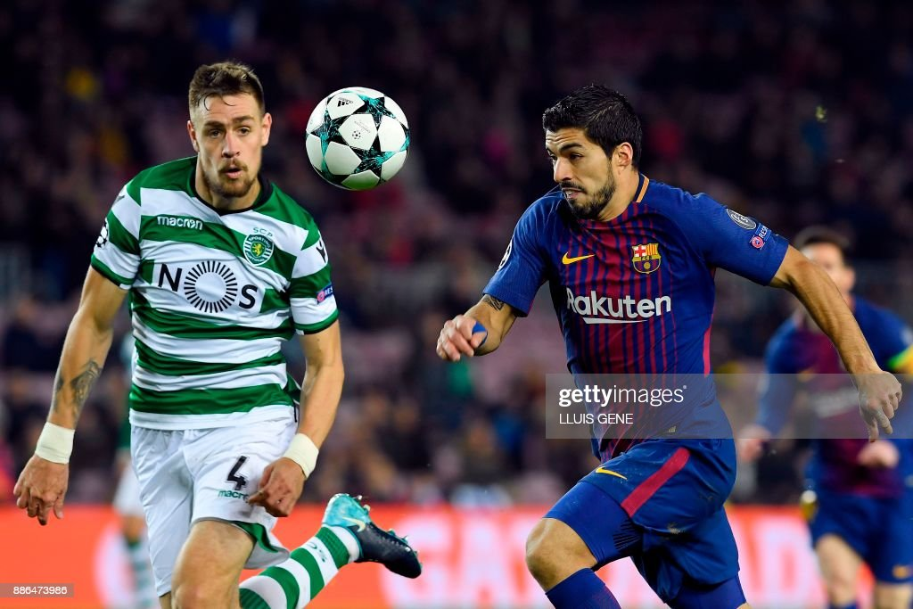 Sporting's Uruguayan defender Sebastien Coates challenges Barcelona's Uruguayan forward Luis Suarez (R) during the UEFA Champions League football match FC Barcelona vs Sporting CP at the Camp Nou stadium in Barcelona on December 5, 2017. /