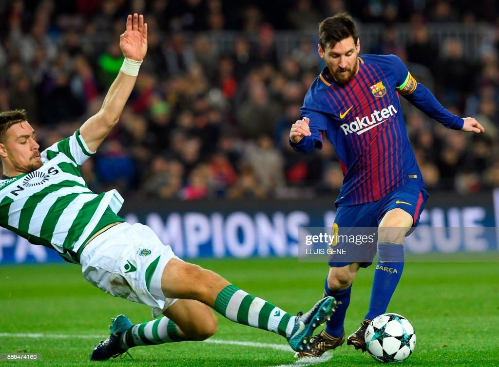 TOPSHOT - Sporting's Uruguayan defender Sebastien Coates (L) challenges Barcelona's Argentinian forward Lionel Messi during the UEFA Champions League football match FC Barcelona vs Sporting CP at the Camp Nou stadium in Barcelona on December 5, 2017. /
