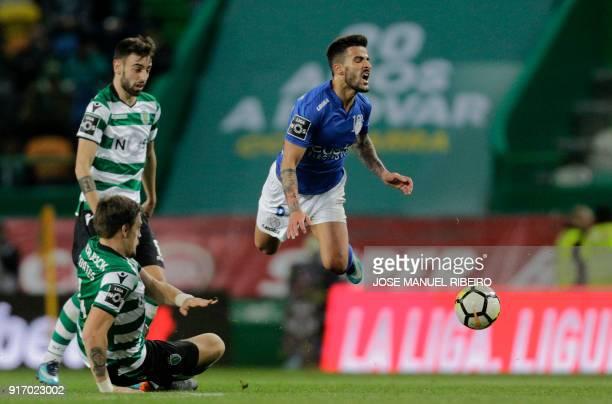 Sporting's Uruguayan Sebastian Coates tackles Feirenses Portuguese midfielder Tiago Silva during the Portuguese league football match between...