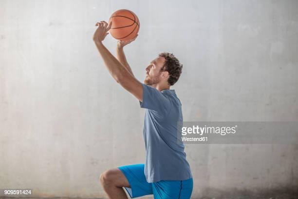 Sportive man throwing a basketball