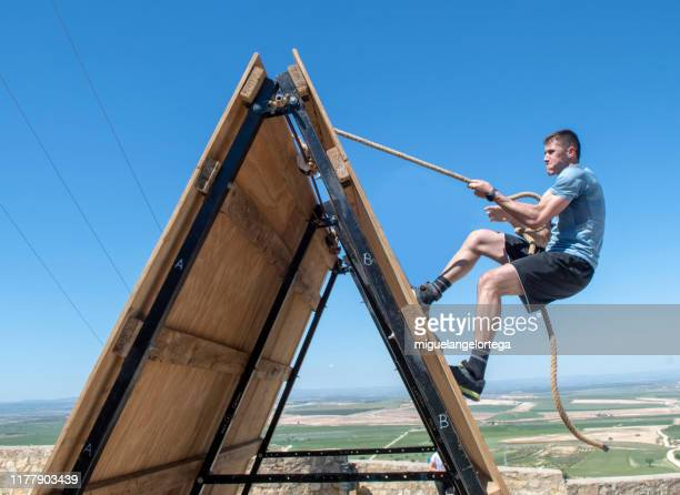 sportman in a obstacle course racing - obstacle course stock pictures, royalty-free photos & images
