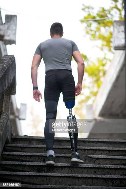 Sportman with prosthetic leg.