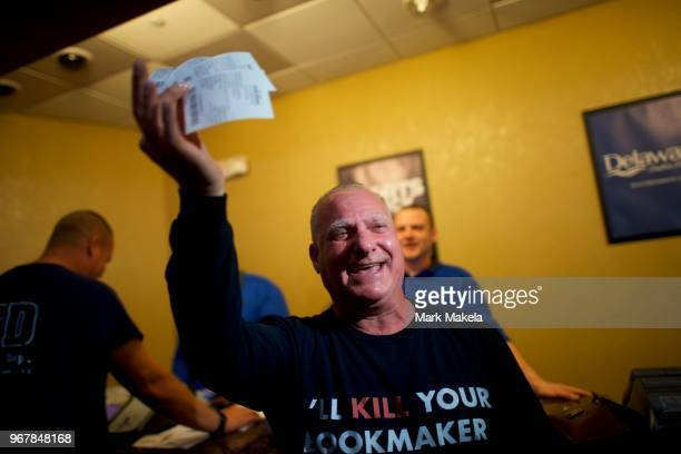 Sports Adviser Stuart Feiner who was portrayed by actor Al Pacino in the film Two for the Money displays his betting tickets at Dover Downs Casino on...