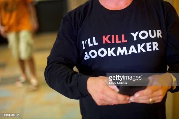 Sports Adviser Stuart Feiner who was portrayed by actor Al Pacino in the film Two for the Money wears a tshirt stating I'll KILL YOUR BOOKMAKER...