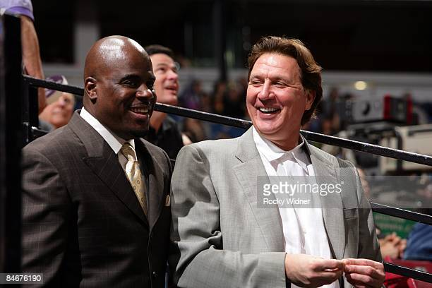 Sports agent Aaron Goodwin and Sacramento Kings General Manager Geoff Petrie chat during the game against the Oklahoma City Thunder at Arco Arena on...