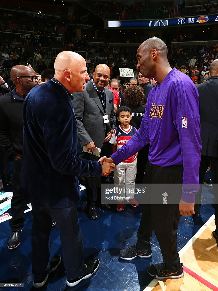 Sports Agent, David Falk greets Kobe Bryant #24 of the Los Angeles Lakers before the game against the Washington Wizards on December 2, 2015 at Verizon Center in Washington, DC.