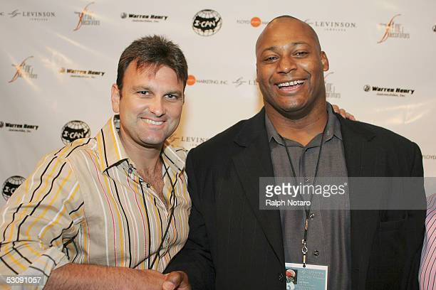 "Sports agent Drew Rosenhaus and Miami Dolphin Alumni Jeff Cross pose for photos during the Jim Brown ""Legends"" Event at the Park Sports Club at..."