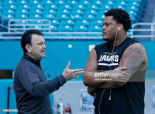 Sports agent Drew Rosenhaus talks to Ereck Flowers of the Jacksonville Jaguars prior to the NFL game against the Miami Dolphins on December 23, 2018...