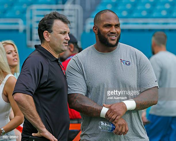 Sports agent Drew Rosenhaus talks to Jurrell Casey of the Tennessee Titans prior to the preseason game against the Miami Dolphins on September 1,...