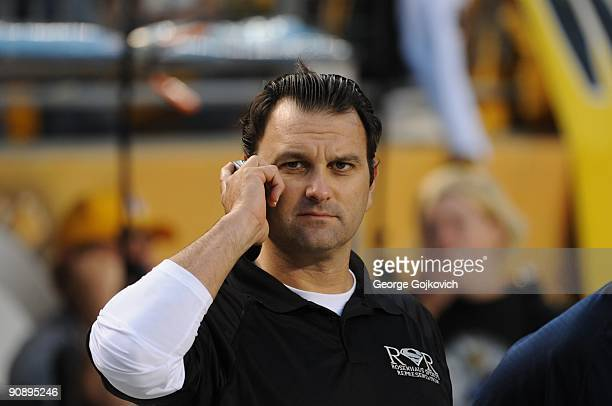 Sports agent Drew Rosenhaus uses a cell phone on the sideline before a game between the Tennessee Titans and Pittsburgh Steelers at Heinz Field on...
