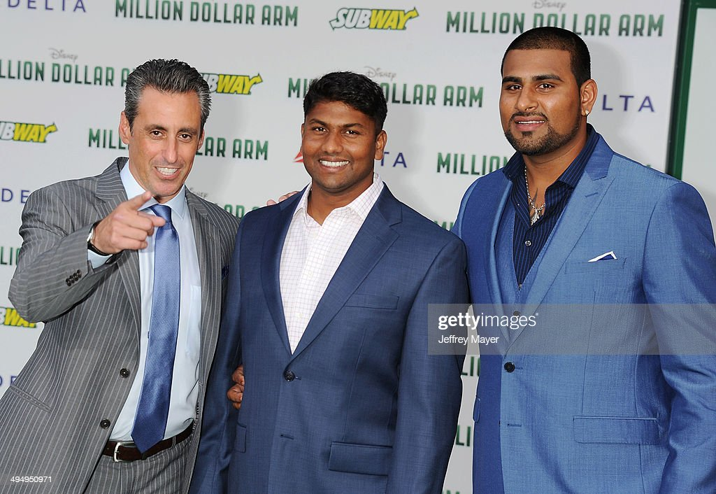 Sports agent J.B. Bernstein, Dinesh Patel and Rinku Singh arrive at the Los Angeles premiere of 'Million Dollar Arm' at the El Capitan Theatre on May 6, 2014 in Hollywood, California.