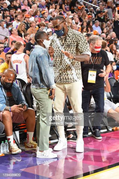 Sports Agent, Rich Paul talks to LeBron James of the Los Angeles Lakers during Game Five of the 2021 NBA Finals on July 17, 2021 at Footprint Center...