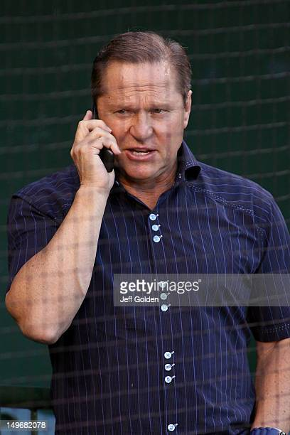 Sports agent Scott Boras talks on his mobile phone as he attends batting practice before the game between the Kansas City Royals and the Los Angeles...