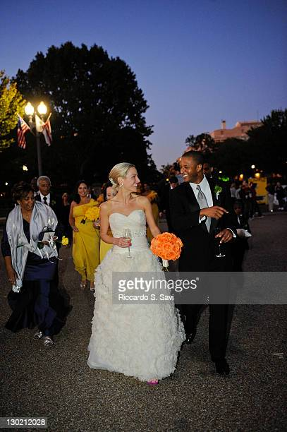 ESPN sports anchor Lindsay Czarniak and MSNBC anchor and NBC News correspondent Craig Melvin walk near Lafayette Park after their wedding on October...