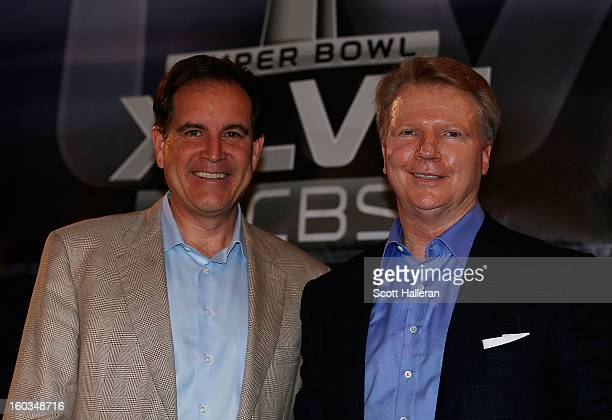 Sports announcers Jim Nantz and Phil Simms pose on stage at a CBS Super Bowl XLVII Broadcasters Press Conference at the New Orleans Convention Center...