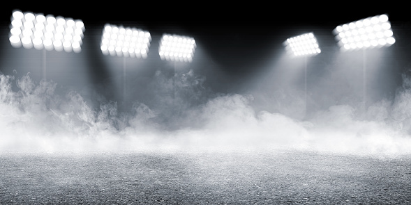 Sports arena with concrete floor with smokes and spotlights 1135438312