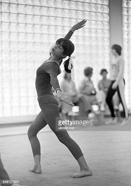 sports artistic gymnastics floor exercises gymnast girl aged 16 to 20 years DOberhausen Ruhr area North RhineWestphalia