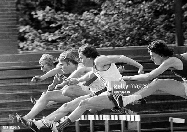 Sports, Athletics, district championships 1973 in the Jahn Stadium Bottrop, hurdling, men, D-Bottrop, Ruhr area, North Rhine-Westphalia -