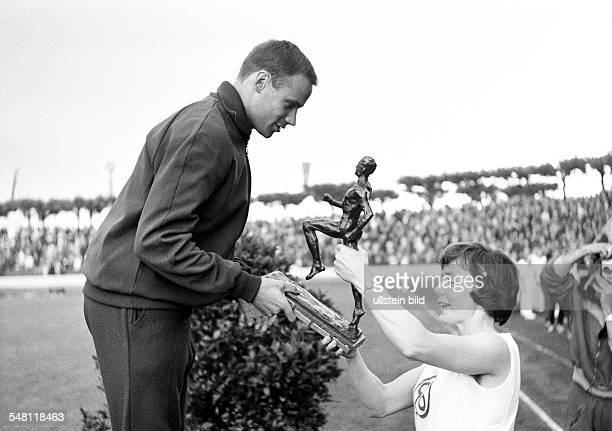 sports athletics German Championships in Athletics 1965 in Duisburg Wedau Stadium nowadays MSV Arena Manfred Kinder from Wuppertaler SV obtains the...