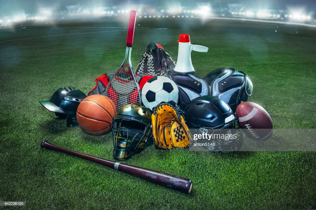Sports balls on the field with yard line. Soccer ball, American football and Baseball in yellow glove on green grass. Outdoors : Stock Photo