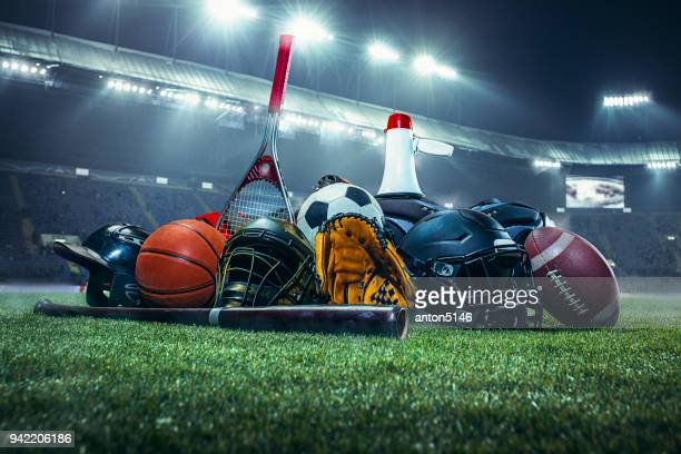 sports balls on the field with yard line. soccer ball, american football and baseball in yellow glove on green grass. outdoors - sports ball stock pictures, royalty-free photos & images
