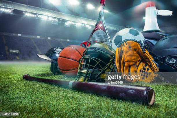 sports balls on the field with yard line. soccer ball, american football and baseball in yellow glove on green grass. outdoors - sports equipment stock pictures, royalty-free photos & images