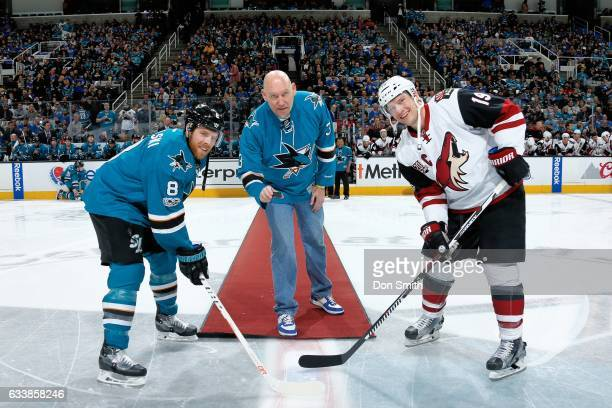 Sports broadcaster and former Golden State Warriors player Tom Tolbert drops the ceremonial puck with Joe Pavelski of the San Jose Sharks and Shane...