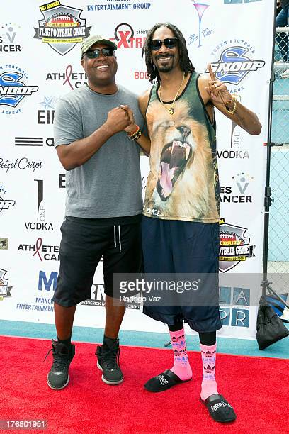 Sports broadcaster Rodney Peete and rapper Snop Dogg attend the 1st Annual Athletes Center Celebrity Flag Football on August 18 2013 in Pacific...
