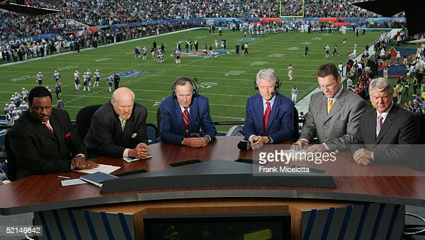 FOX Sports Broadcasters James Brown Terry Bradshaw Howie Long and Jimmy Johnson with Former US Presidents Bill Clinton and George Bush prepare for...
