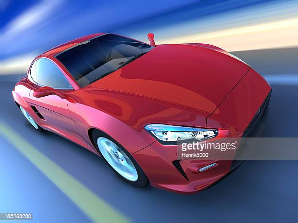 Sports car driving along beach, clipping path included