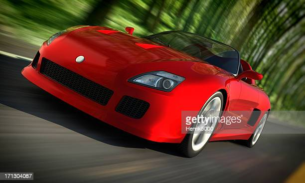 Sports car driving fast in forest