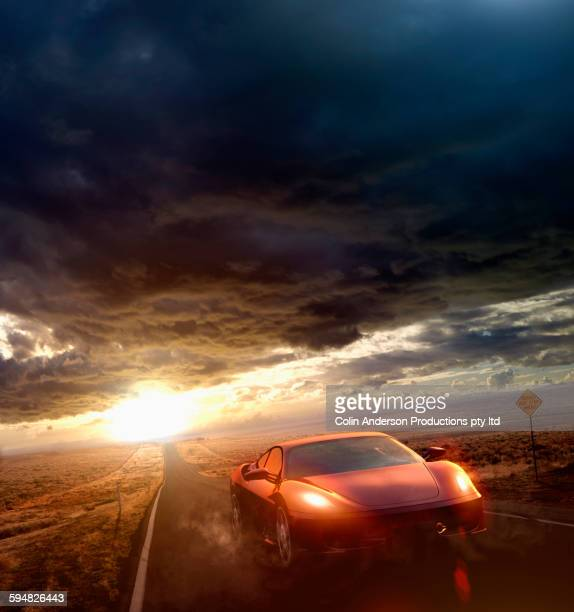 Sports car driving on remote road