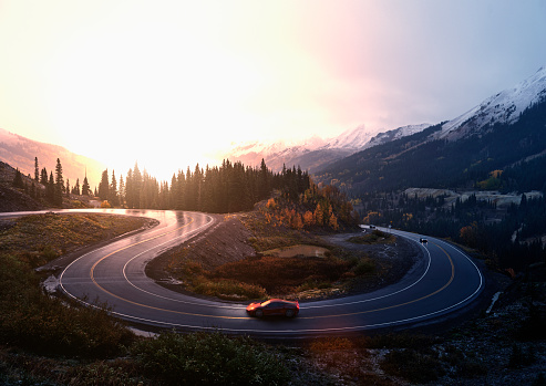Sports car driving on winding remote road - gettyimageskorea