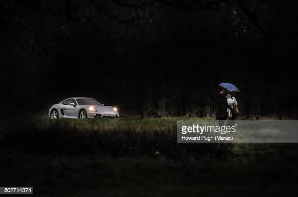 Sports Car Headlights Couple in the Rain