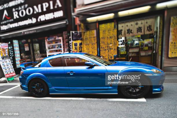 sports car in the akihabara district of tokyo, japan - customized car stock pictures, royalty-free photos & images