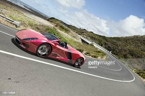 Sports Car on a Coastal Road