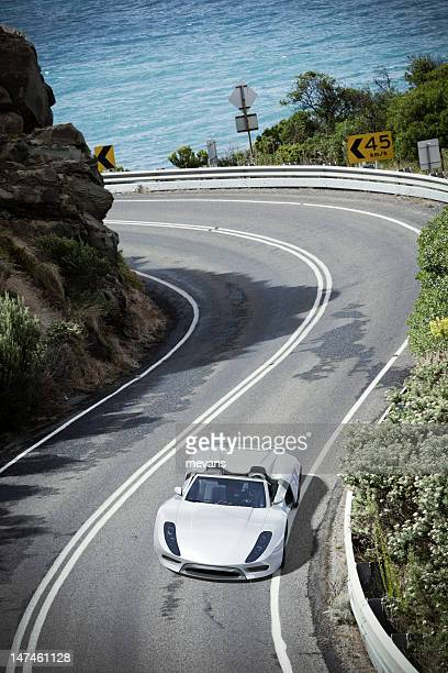sports car on a coastal road - smart car stock photos and pictures