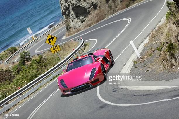 Sports Car on Coastal Road.