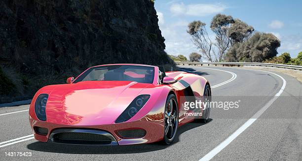 sports car on coastal road. - muscle car stock photos and pictures