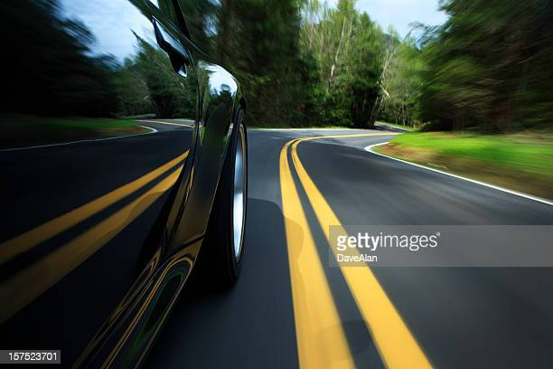 sports car on country road. - dividing line road marking stock pictures, royalty-free photos & images