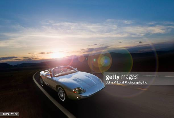 Sports car on remote highway
